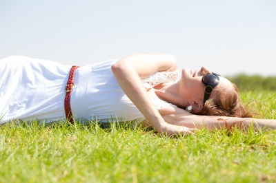 woman lying in field
